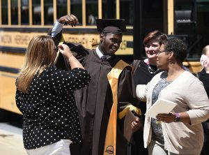 MHS graduate celebrates with family following Commencement.