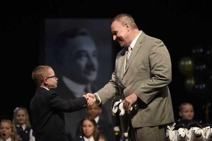 An MHS fourth-grader receives a token of achievement