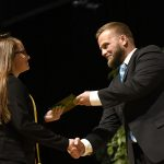 MHS rising ninth-grader receives her certificate during the Eighth Grade Promotion Ceremony.