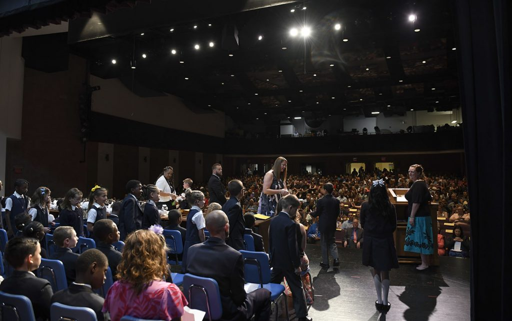 MHS fourth-graders recognized on stage during their promotion ceremony.
