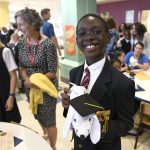 An MHS rising fifth-grader celebrates after the Fourth Grade Promotion Ceremony.