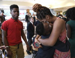 A rising MHS fifth-grader celebrates with family.