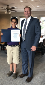 Dauphin County Commission Mike Pries congratulates MHS student Iziah on placing third in a diversity essay contest.
