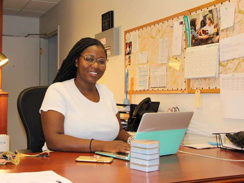 MHS Transitional Living staff Sesay Bayoh works at her desk.
