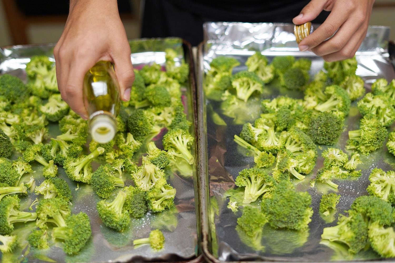 Milton Hershey School junior, Eli, cooking broccoli in his student home.