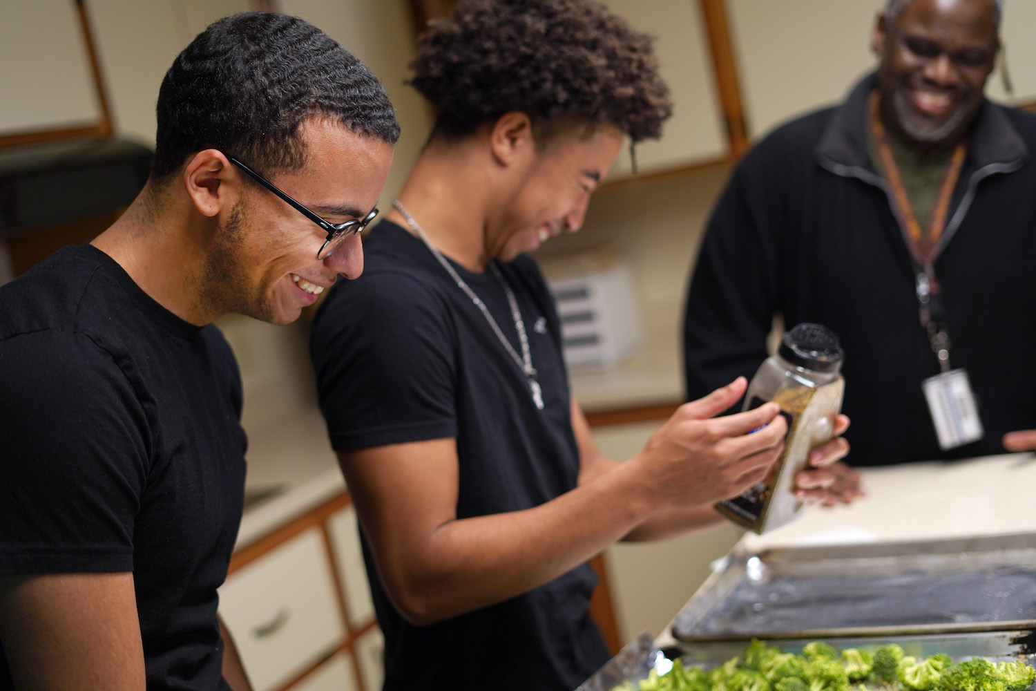 Milton Hershey School junior, Eli, cooks with a fellow student in his student home.