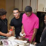 Milton Hershey School junior, Eli, cooks with healthy alternatives in the kitchen of his student home.