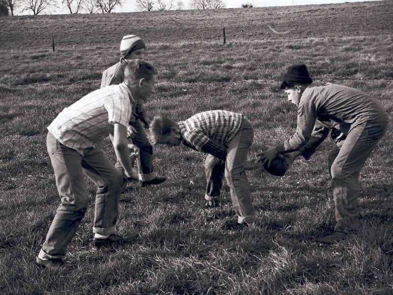 students playing football on Thanksgiving