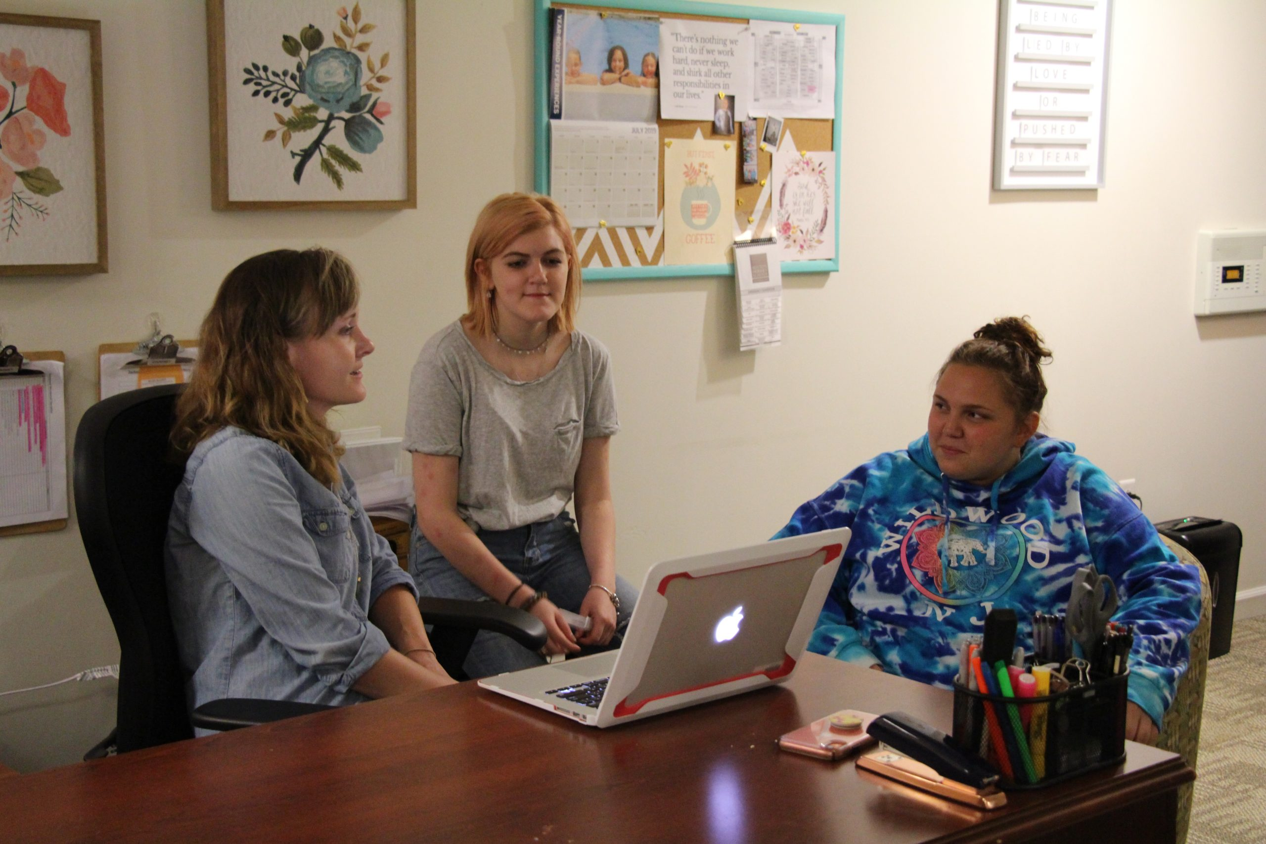 Milton Hershey School Transitional Living Coordinator, Lindsey Young, meets with students to plan activities in the TL.