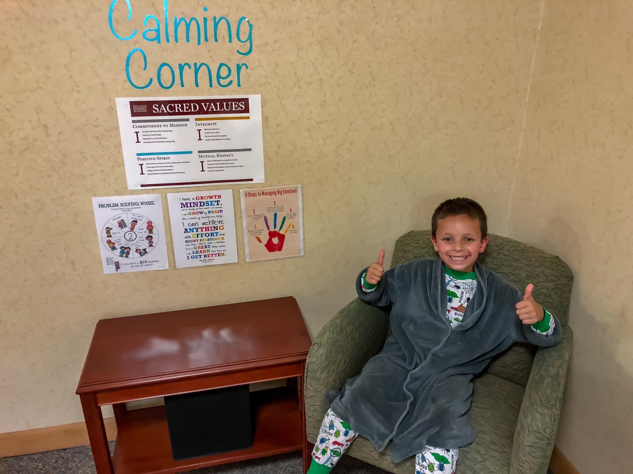 A Milton Hershey School students poses for a photo in the calming corner that his houseparents set up in the student home.