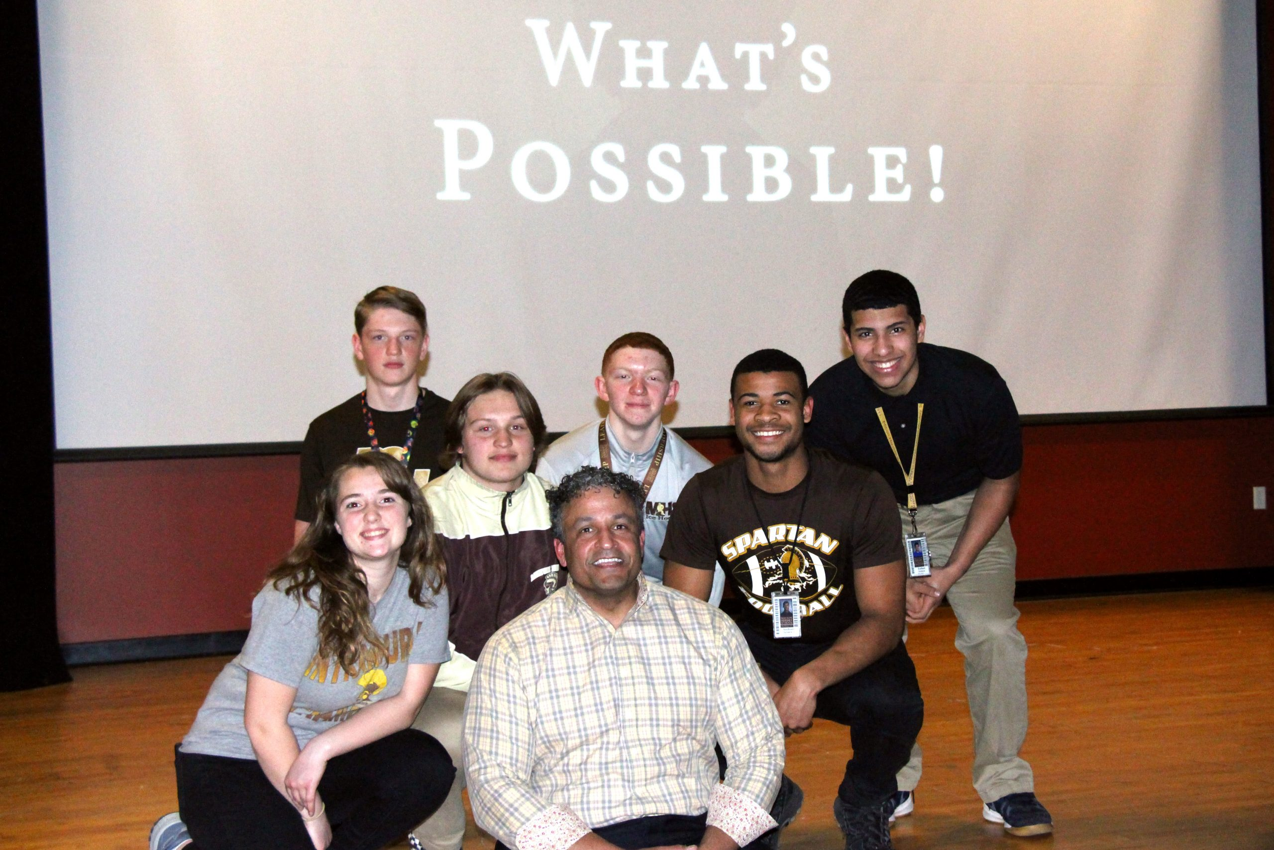 Author JT McCormick poses for a group photo with Milton Hershey School students during a recent visit to the school.