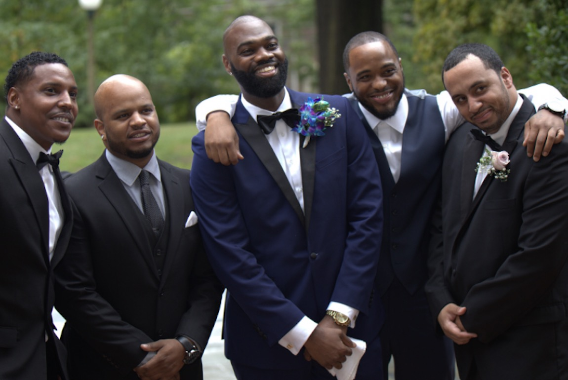 Milton Hershey School alumnus Brian Washington '03 at his wedding with another graduate serving as his best man.