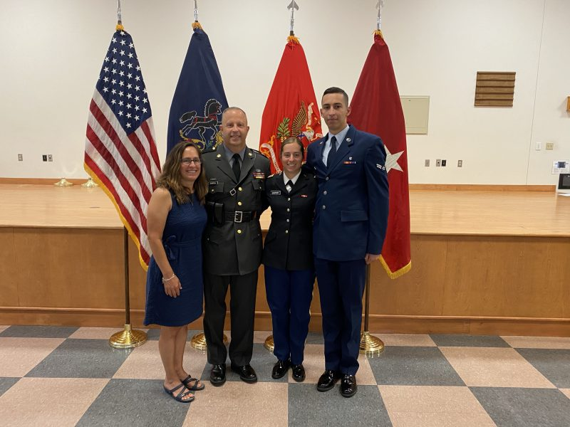 Analyse Gaspich with family at officer graduation