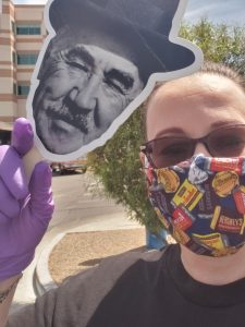 Milton Hershey School alumna, Bridget Savadge, takes a selfie in her COVID-19 mask and a cut-out of Milton Hershey.