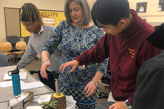 Milton Hershey School students learn how to core a pineapple as part of the school's Hydration Challenge.