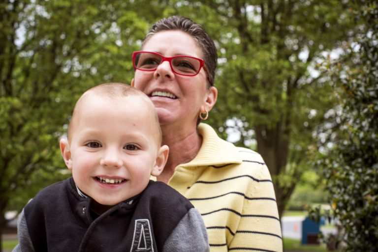 A Milton Hershey School grandmother parent/sponsor smiles with her grandson.