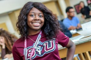 A Milton Hershey School young alumna wears a college t-shirt.